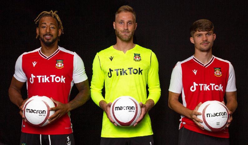 Wrexham players show off their new TikTok kit.
